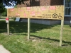 Full-size ruler sign on site, Midtown Village, Holland, MI